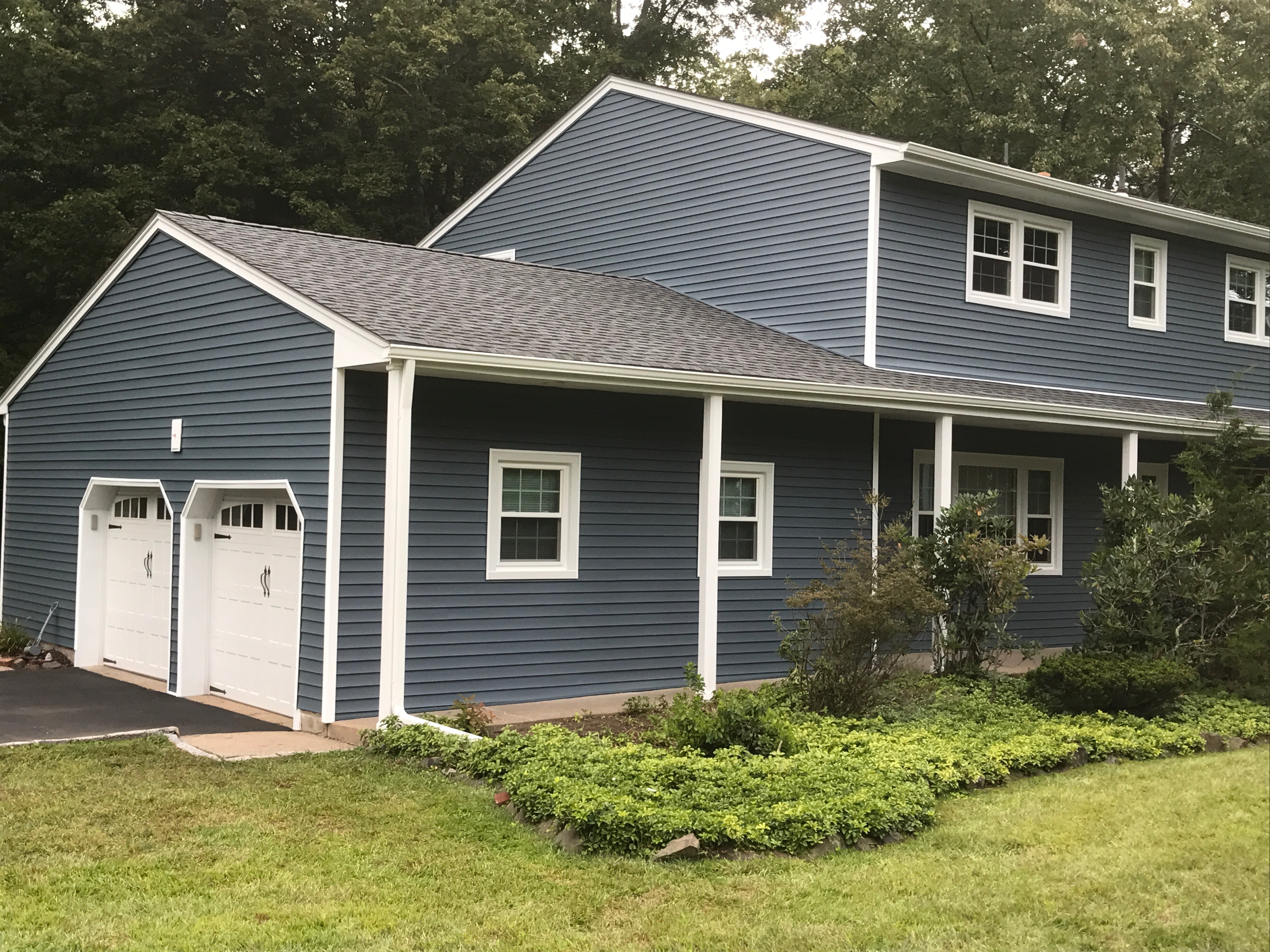 A McCollum Roofing & Siding Project in Montville NJ. New Alside Double 4 Vinyl Siding, Clap Board.